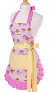 apron with a lot of pin, yellow pockets and tie with bow around waist