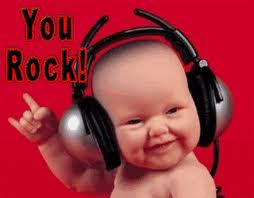 baby with headphones on with words you rock