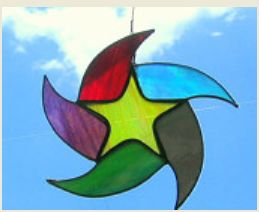 stainglass star with multicolored teardrop rays around