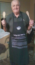 Joan's husband in irish apron that has a recipe for irish stew on it.